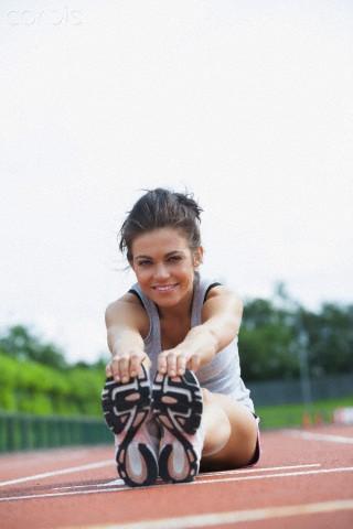 mulher alongando-pilates na corrida